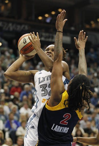 Minnesota Lynx forward Rebekkah Brunson (32) goes up to the basket against Indiana Fever forward Erlana Larkins (2) in the first half of Game 2 of the WNBA basketball Finals Wednesday, Oct. 17, 2012, in Minneapolis. (AP Photo/Stacy Bengs)