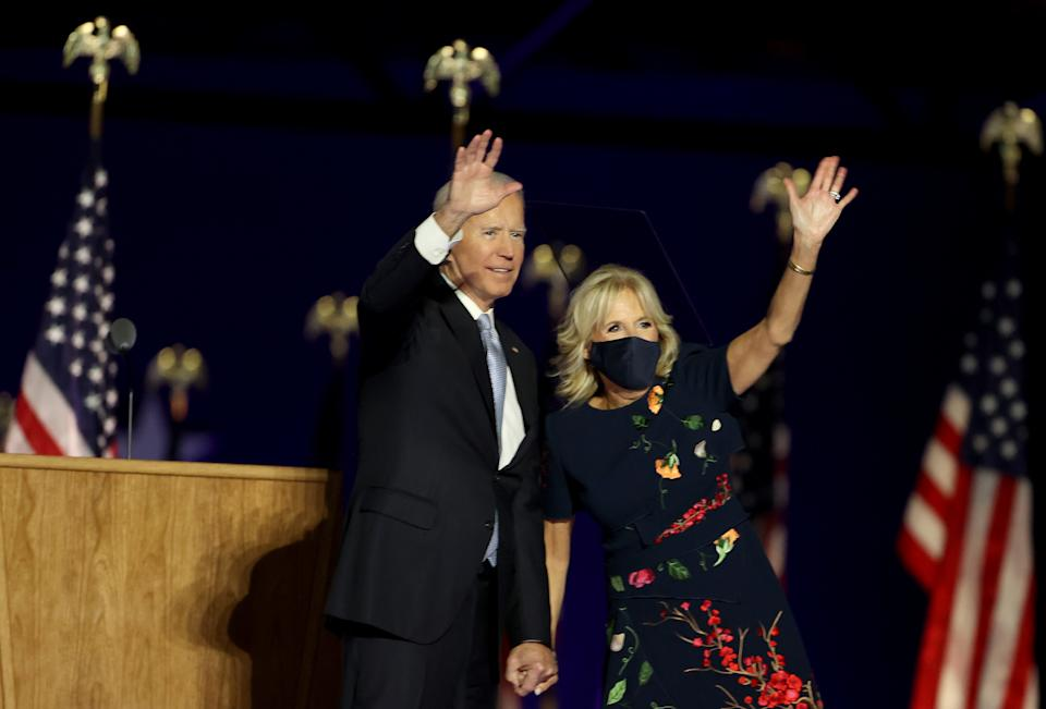 WILMINGTON, DELAWARE - NOVEMBER 07:  President-elect Joe Biden and Jill Biden wave to the crowd after Biden's address to the nation from the Chase Center November 07, 2020 in Wilmington, Delaware. After four days of counting the high volume of mail-in ballots in key battleground states due to the coronavirus pandemic, the race was called for Biden after a contentious election battle against incumbent Republican President Donald Trump. (Photo by Tasos Katopodis/Getty Images)