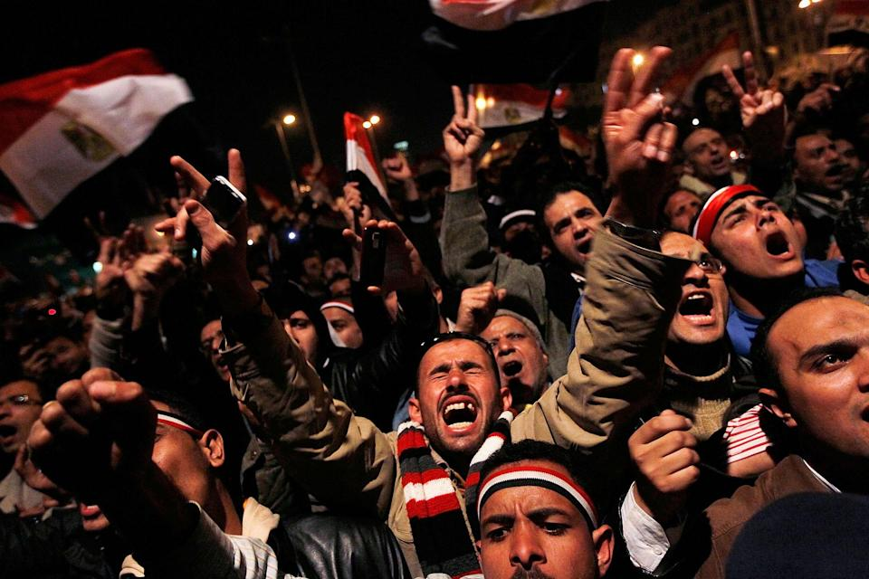 <p>Anti-government protesters rally after a speech by Egyptian President Hosni Mubarak in Tahrir Square February 10, 2011 in Cairo, Egypt. President Hosni Mubarak made a statement saying that he had given some powers to his vice President but would not resign or leave the country, leaving a crowd of anti-government protesters disappointed and furious after early reports he might step down. (Photo by Chris Hondros/Getty Images) </p>