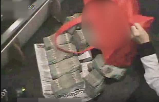 A bag of cash is seen on surveillance video at Starlight Casino in New Westminster, B.C. The photo was released with the Peter German report into money-laundering in 2018.