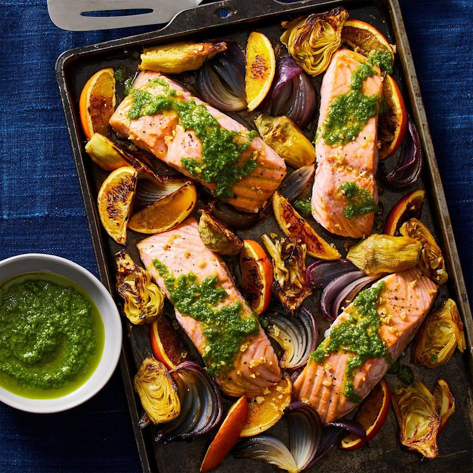 """<p>One great thing about winter? Seafood is at its peak. Make the most of cold weather with this salmon dish, which unites fruits, veggies, and plenty of protein for a satisfying <a href=""""https://www.prevention.com/food-nutrition/recipes/g25703090/sheet-pan-dinners/"""" rel=""""nofollow noopener"""" target=""""_blank"""" data-ylk=""""slk:sheet pan dinner"""" class=""""link rapid-noclick-resp"""">sheet pan dinner</a> that's packed with vitamins and nutrients.</p><p><strong><strong><em><a href=""""https://www.prevention.com/food-nutrition/recipes/a34079549/roasted-salmon-artichokes-red-onion-recipe/"""" rel=""""nofollow noopener"""" target=""""_blank"""" data-ylk=""""slk:Get the recipe »"""" class=""""link rapid-noclick-resp"""">Get the recipe »</a></em></strong></strong></p>"""
