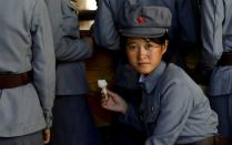 FILE PHOTO: Soldier eats ice cream as she visits a zoo in Pyongyang