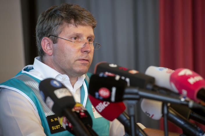 Daniel Knecht, of the Swiss Transportation Safety Investigation Board (STSB), addresses the media during a press conference in Flims, Switzerland, Sunday, Aug. 5, 2018 about the plane crash on Saturday afternoon. The plane, a Junkers Ju-52, crashed on Saturday, Aug. 4, 2018 at the Piz Segnas, all 20 people aboard died. (Melanie Duchene/Keystone via AP)