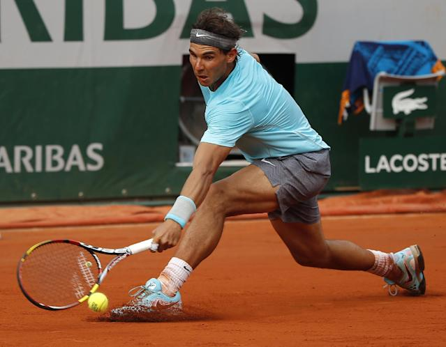 Spain's Rafael Nadal returns the ball to Serbia's Novak Djokovic during their final match of the French Open tennis tournament at the Roland Garros stadium, in Paris, France, Sunday, June 8, 2014. (AP Photo/Michel Euler)