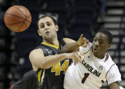 Missouri forward Ryan Rosburg (44) passes the ball against South Carolina guard Marcus Stroman (1) during the second half of an NCAA college basketball game in the first round of the Southeastern Conference tournament, Wednesday, March 11, 2015, in Nashville, Tenn. (AP Photo/Mark Humphrey)