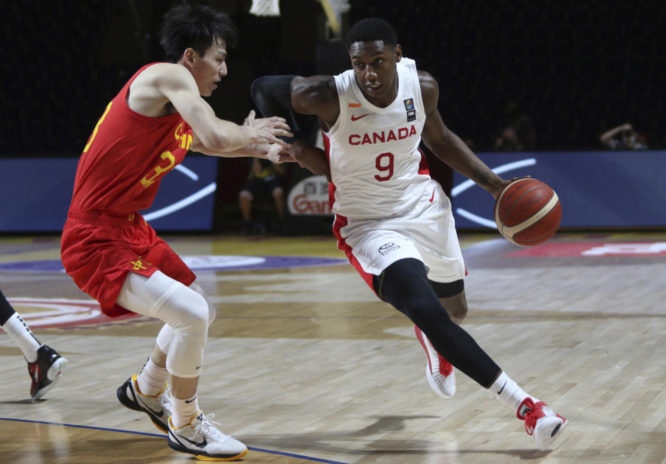 Canada's RJ Barrett drives past China's Qian Wu during the first half of a FIBA men's Olympic basketball qualifying game Wednesday, June 30, 2021, in Victoria, British Columbia. (Chad Hipolito/The Canadian Press via AP)
