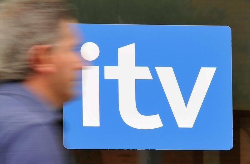 A man passes ITV television studios in London