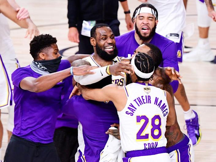 LA Lakers celebrate after winning the NBA ChampionshipGetty Images