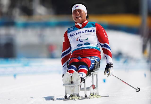 Cross-Country Skiing - Pyeongchang 2018 Winter Paralympics - Ladies' 12 KM - Sitting - Alpensia Biathlon Centre - Pyeongchang, South Korea - March 11, 2018 - Lee Do-yeon of South Korea reacts at the finish line. REUTERS/Carl Recine