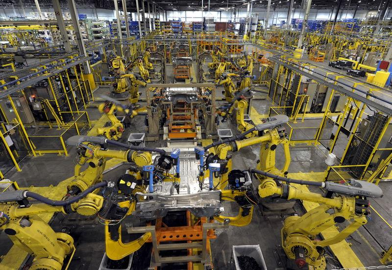 Robotic arms rivet floor panels at Ford's plant where new aluminum intensive Ford F-Series pickups are built in Claycomo Missouri