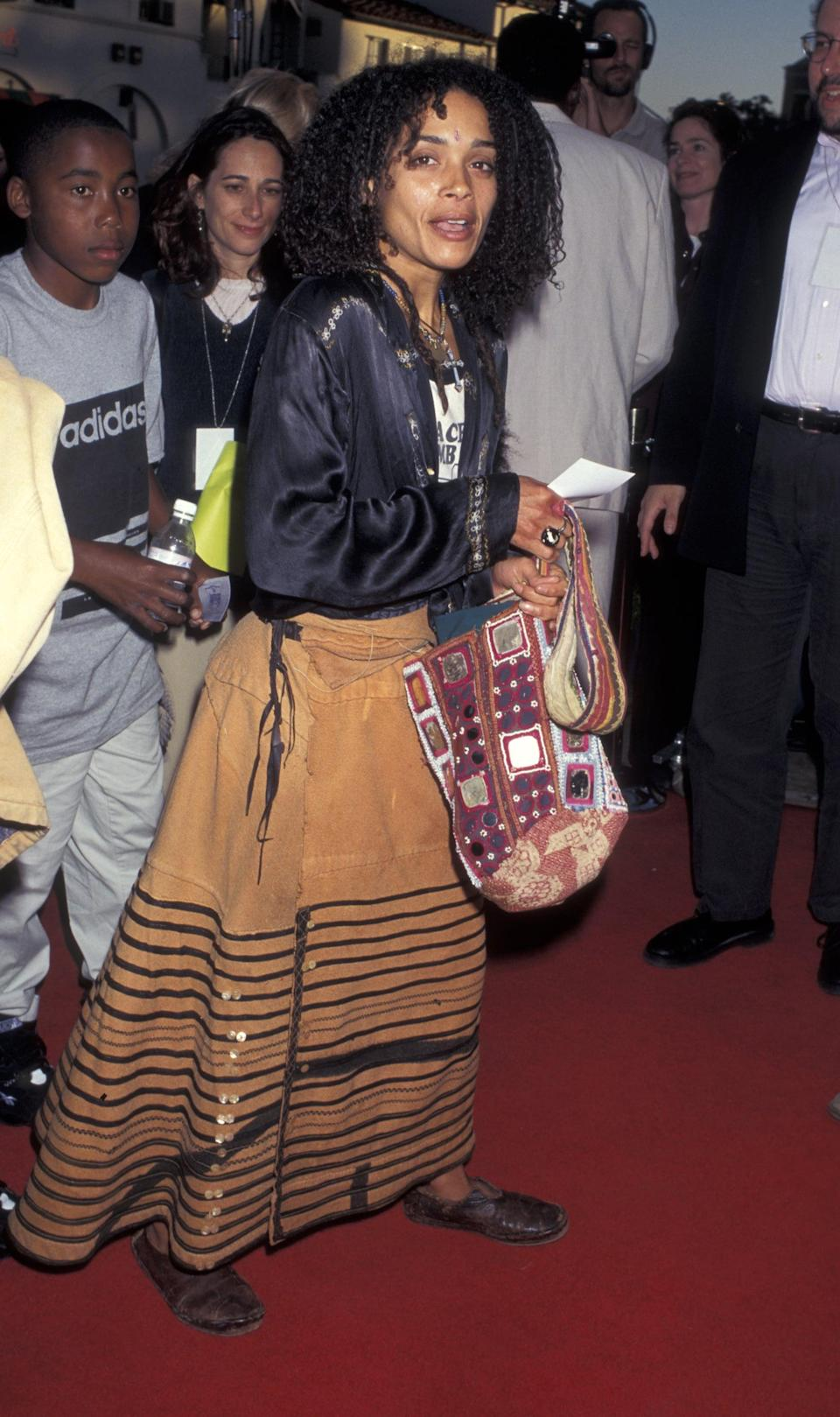 """<p>Lisa Bonet attended <strong>The Aristocats </strong>1996 video release premiere in both an edgy and laid-back look by pairing a brown maxi skirt with a silk onyx blouse. It's clear that <span class=""""title-text   """">Zoë</span> Kravitz gets some of her <a href=""""https://www.popsugar.com/fashion/zoe-kravitz-best-style-moments-47256637"""" class=""""link rapid-noclick-resp"""" rel=""""nofollow noopener"""" target=""""_blank"""" data-ylk=""""slk:stylish sensibilities"""">stylish sensibilities</a> from her mom!</p>"""