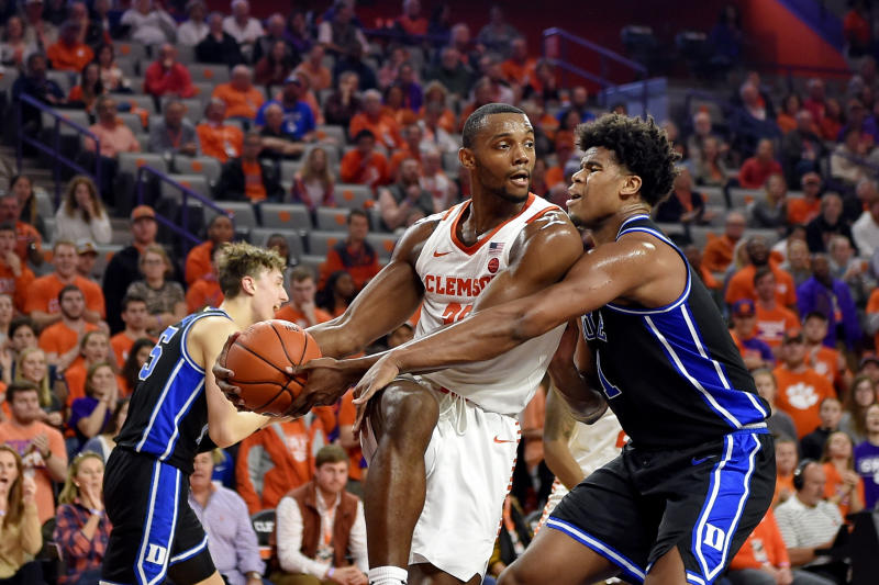 Clemson's Aamir Simms grabs a rebound while defended by Duke's Vernon Carey Jr. during the first half of an NCAA college basketball game Tuesday, Jan. 14, 2020, in Clemson, S.C. (AP Photo/Richard Shiro)