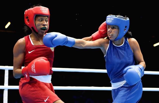 LONDON, ENGLAND - AUGUST 05: Karlha Magiliocco of Venuzuela (R) in action with Erica Matos of Brazil during the Women's Fly (48-51kg) Boxing on Day 9 of the London 2012 Olympic Games at ExCeL on August 5, 2012 in London, England. (Photo by Scott Heavey/Getty Images)