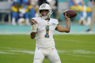 Miami Dolphins quarterback Tua Tagovailoa (1) looks to pass the football during the first half of an NFL football game against the Los Angeles Chargers, Sunday, Nov. 15, 2020, in Miami Gardens, Fla. (AP Photo/Wilfredo Lee)