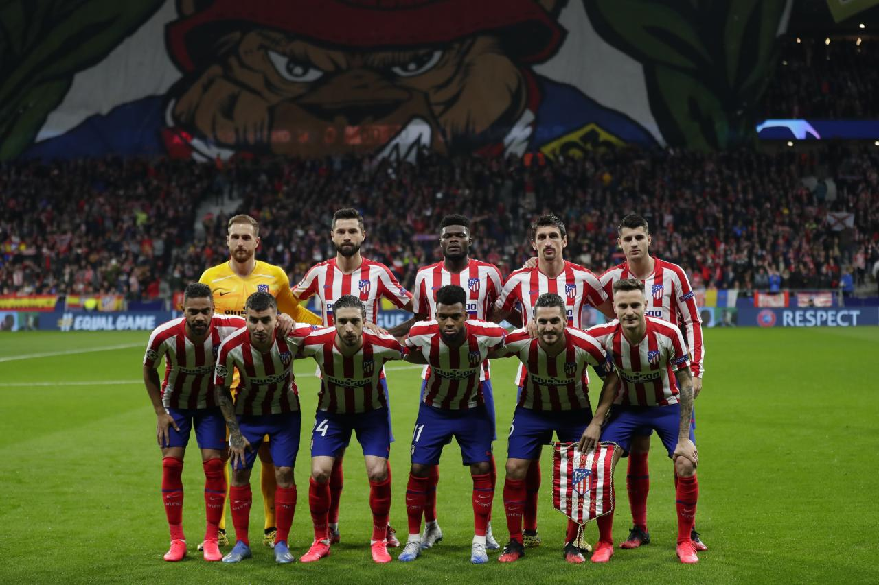 Atletico Madrid players pose before a 1st leg, round of 16, of the Champions League soccer match between Atletico Madrid and Liverpool at the Wanda Metropolitano stadium in Madrid, Tuesday, Feb. 18, 2020. (AP Photo/Manu Fernandez)