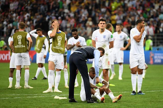Gareth Southgate picks up his players after the loss.