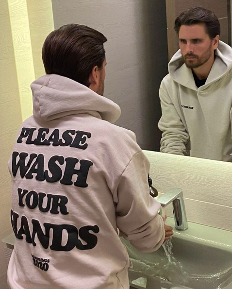 Scott Disick washing his hands
