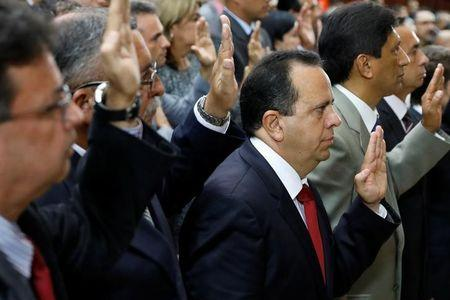 Rodolfo Marco Torres, newly elected governor of Aragua state, is sworn in to the National Constituent Assembly during a ceremony at Palacio Federal Legislativo, in Caracas