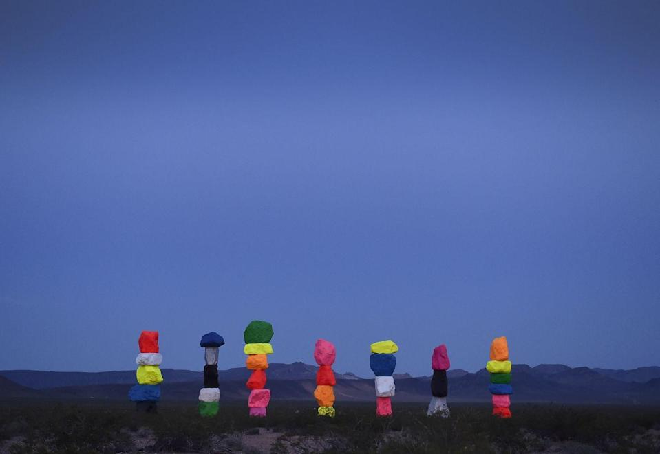 "<p>Standing in the midst of the Las Vegas desert, is this <a href=""http://sevenmagicmountains.com/"" rel=""nofollow noopener"" target=""_blank"" data-ylk=""slk:brightly colored art installation"" class=""link rapid-noclick-resp"">brightly colored art installation</a>. It is seven towers of vivid boulders stacked 30 feet high, which bring color to the dry landscape around it. It's currently slated to be there until 2021.</p>"