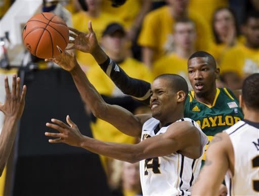 Missouri's Kim English, left, passes the ball as he is defended by Baylor's Cory Jefferson, right, during the first half of an NCAA college basketball game, Saturday, Feb. 11, 2012, in Columbia, Mo. (AP Photo/L.G. Patterson)