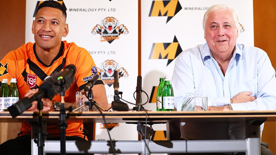Israel Folau and Clive Palmer, pictured here speaking to the media in Brisbane.