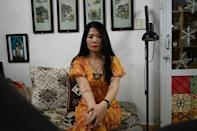 "Nguyen Hong Thai chose a rose tattoo over a scar on her stomach, and the words ""forever in my heart"" on her arm, months after her husband died of lung cancer"