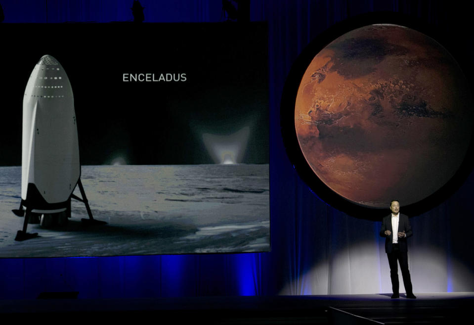FILE - In this Tuesday, Sept. 27, 2016 file photo, SpaceX founder Elon Musk speaks during the 67th International Astronautical Congress in Guadalajara, Mexico. Starting with the dream of growing a rose on Mars, Musk's vision morphed into a shake-up of the old space industry, and a fleet of new private rockets. In 2020, those rockets are scheduled to launch NASA astronauts from Florida to the International Space Station -- the first time a for-profit company will carry astronauts into the cosmos. (AP Photo/Refugio Ruiz)