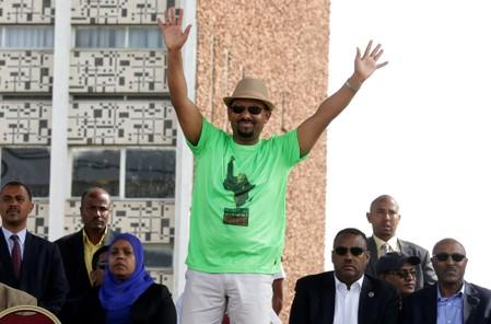 FILE PHOTO: Ethiopian Prime Minister Abiy Ahmed waves to supporters as he attends a rally in Addis Ababa