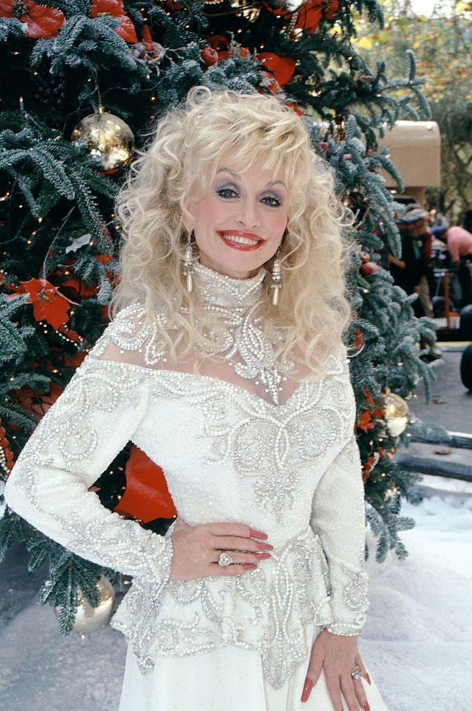 <p>Here, Parton poses as the Christmas spirit. </p>