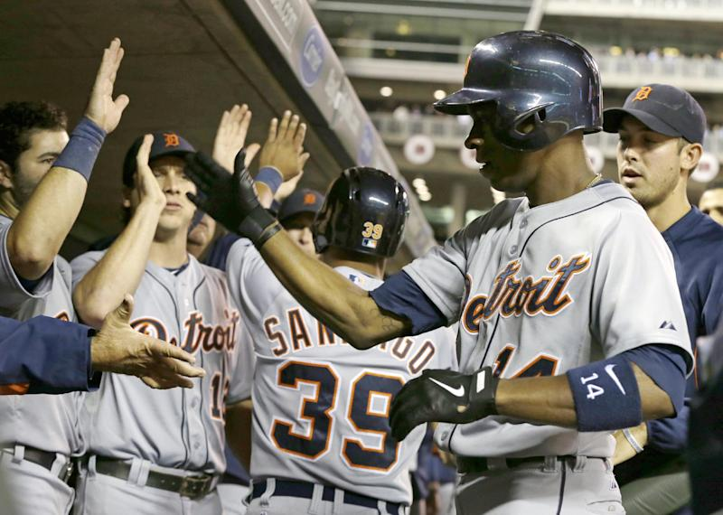 Detroit Tigers' Austin Jackson, right, is greeted in the dugout after his two-run home run off Minnesota Twins pitcher Scott Diamond in the fourth inning of a baseball game, Tuesday, Sept. 24, 2013, in Minneapolis. (AP Photo/Jim Mone)