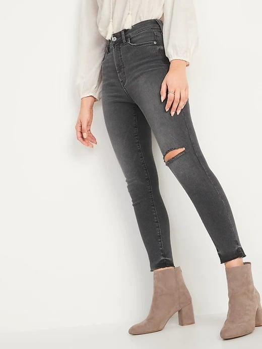 <p>If you're looking for faded black jeans, look no further than these whiskered <span>Old Navy Extra High-Waisted Rockstar 360° Stretch Super Skinny Ripped Gray Cut-Off Ankle Jeans for Women</span> ($40, originally $49).</p>