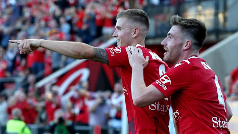 A late Riley McGree (L) goal has given Adelaide United a 1-0 A-League win over Brisbane
