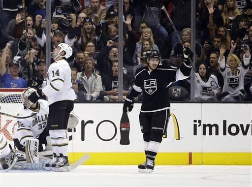 Los Angeles Kings' Mike Richards (10) celebrates his goal as Dallas Stars goalie Kari Lehtonen (32) and Jamie Benn(14) look on during the first period of an NHL hockey game in Los Angeles, Sunday, April 21, 2013. (AP Photo/Jae C. Hong)