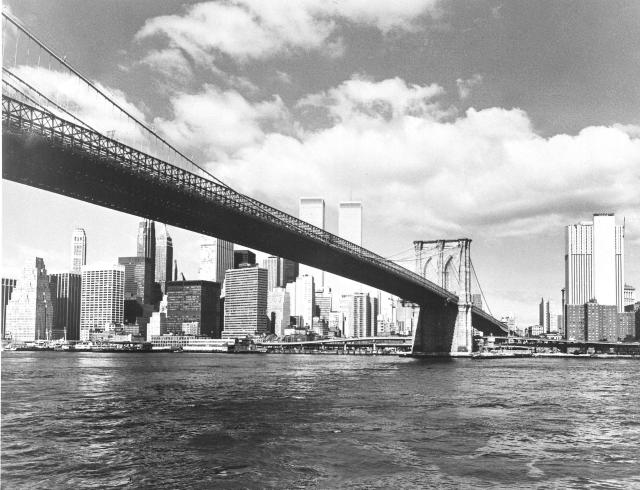 This undated photo shows the Brooklyn Bridge, which spans the East River, and the lower Manhattan skyline. At center, left of the bridge, are the Twin Towers. (AP Photo)