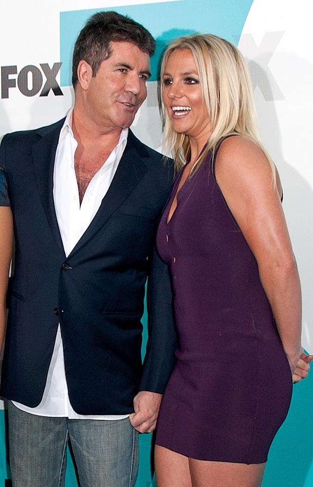 "Simon Cowell is urging Britney Spears to ""break up"" with Jason Trawick, reports <i>Star.</i> The mag reveals it's because the ratings-hungry Cowell wants Spears to have a major ""breakdown"" on ""X Factor,"" but he knows it's impossible with Trawick keeping ""watch over"" her. For how incredibly close Spears is to cracking under Cowell's pressure, log on to <a target=""_blank"" href=""http://www.gossipcop.com/simon-cowell-breaking-up-britney-spears-jason-trawick-x-factor-fight-feud/"">Gossip Cop</a>."