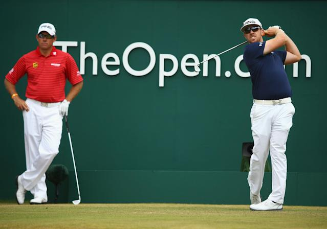 GULLANE, SCOTLAND - JULY 21: Hunter Mahan of the United States tees off alongside Lee Westwood of England on the 1st tee during the final round of the 142nd Open Championship at Muirfield on July 21, 2013 in Gullane, Scotland. (Photo by Matthew Lewis/Getty Images)