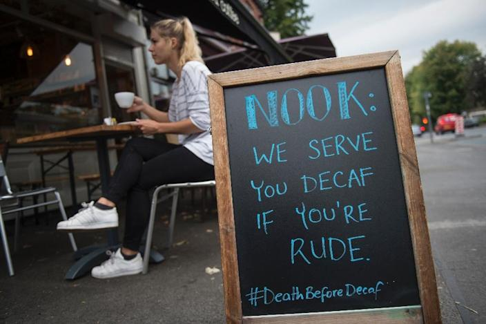 The Nook Neighbourhood Coffee shop advertises its coffee with a contentious phrase written on a chalkboard in Stockport (AFP Photo/Oli Scarff)