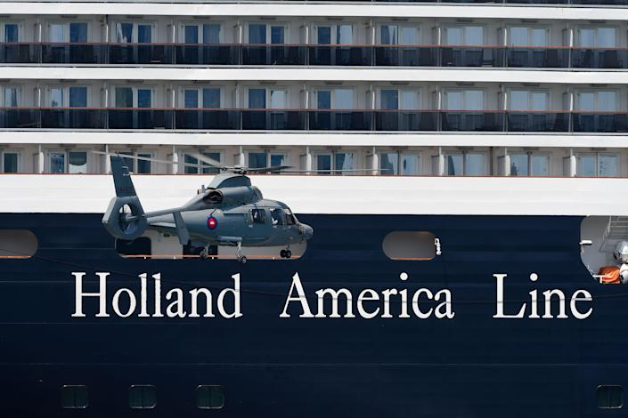 A helicopter approaching the Westerdam cruise ship in Sihanoukville, Cambodia, on Wednesday. (Tang Chhin Sothy/AFP via Getty Images)