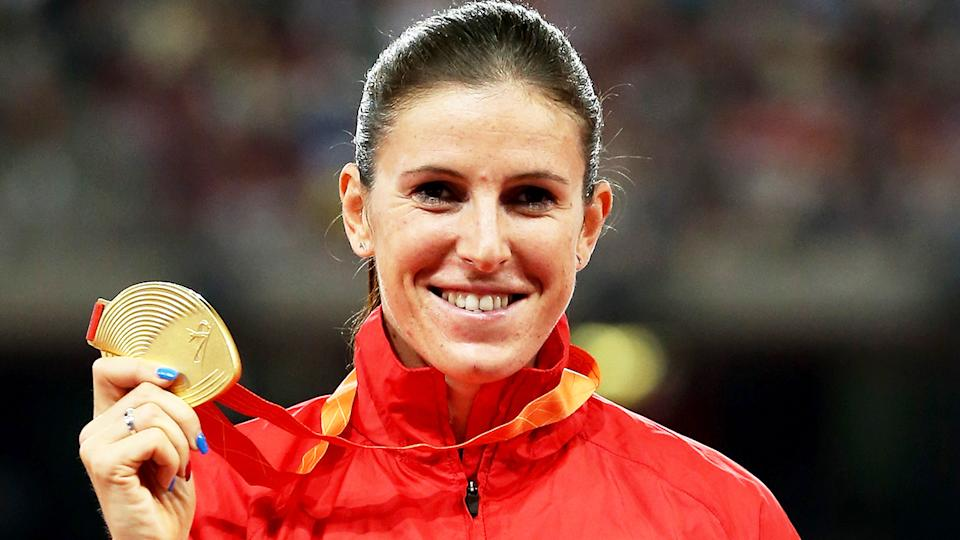 Zuzana Hejnova (pictured) smiling as she holds the Olympic gold medal.