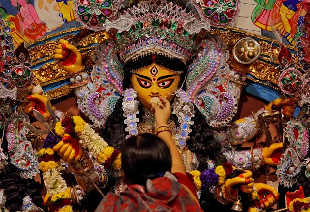 <p>A devotee offers sweets to an idol of the Hindu goddess Durga while offering prayers on the last day of the Durga Puja festival in Kolkata, India, Sept. 30, 2017. (Photo: Rupak De Chowdhuri/Reuters) </p>