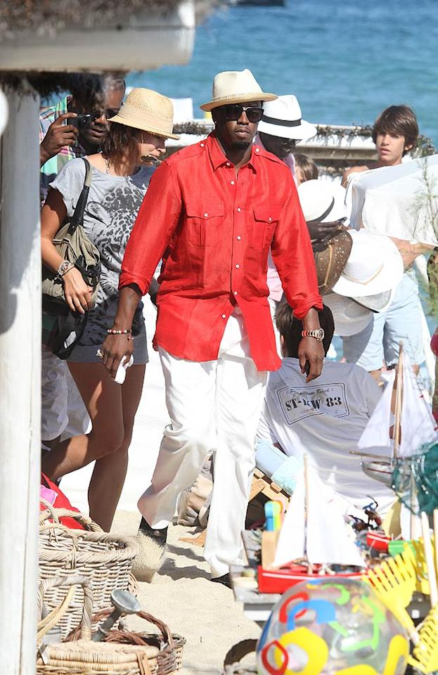 """Sean """"Diddy"""" Combs was looking sharp while on holiday in Saint-Tropez, France. Of course, the hip-hop mogul was busy hosting parties at the hottest clubs along the French Riviera including Le Club 55 and the VIP Room. """"ST TROPEZ!!! VIP Night Club!! Meet me there NOW!! LETS GOOO!!!"""" he tweeted excitedly. KCSPresse/<a href=""""http://www.splashnewsonline.com/"""" target=""""new"""">Splash News</a> - July 30, 2011"""