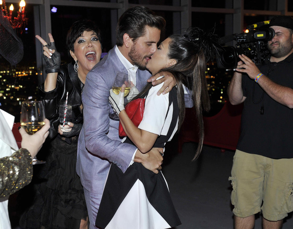 """Kylie Jenner continued her weeklong birthday celebration on Saturday night with her biggest bash yet: An """"Alice in Wonderland""""-themed Sweet 16 party at the AT&T Center in Los Angeles for 200 of her nearest and dearest friends and her famous family, who apparently had a fabulous time, too! Although it wasn't Kylie's mom Kris Jenner's birthday, the talk show host was having a ball as she popped up just in time to interrupt a hot-and-heavy moment between her oldest daughter, Kourtney, and Kourtney's boyfriend Scott Disick. Back off, Kris!"""