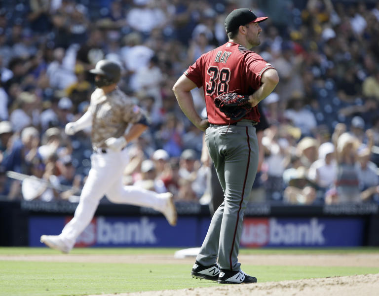 Arizona Diamondbacks starting pitcher Robbie Ray, right, looks away as San Diego Padres' Ty France rounds the bases after hitting a two-run home run during the fourth inning of a baseball game in San Diego, Sunday, Sept. 22, 2019. (AP Photo/Alex Gallardo)