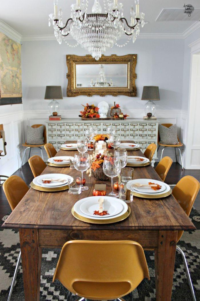 """<p>Sometimes all you need for a beautiful holiday table are pops of orange and gold. </p><p><strong>Get the tutorial at <a href=""""http://dreambookdesign.com/2015/09/diy-wooden-candle-holder-centerpiece/"""" rel=""""nofollow noopener"""" target=""""_blank"""" data-ylk=""""slk:Dream Book Design"""" class=""""link rapid-noclick-resp"""">Dream Book Design</a>.</strong></p><p><strong><a class=""""link rapid-noclick-resp"""" href=""""https://www.amazon.com/Mega-Candles-Unscented-Receptions-Celebrations/dp/B00ATGA136?tag=syn-yahoo-20&ascsubtag=%5Bartid%7C10050.g.2130%5Bsrc%7Cyahoo-us"""" rel=""""nofollow noopener"""" target=""""_blank"""" data-ylk=""""slk:SHOP WHITE CANDLES"""">SHOP WHITE CANDLES</a><br></strong></p>"""
