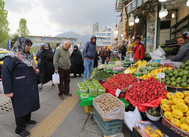 Iranian shoppers say inflation is putting pressure on food and housing prices, as they brace for more pain from US sanctions (AFP Photo/ATTA KENARE)