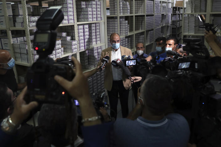 Caretaker Health Minister Hamad Hassan, speaks to journalists during his visit to a medical warehouse in Beirut, Lebanon, Friday, June 11, 2021. Hassan raids warehouses in an effort to control those who are hoarding subsidized medical equipment and baby formula in order to sell them later at higher prices or on the black market. (AP Photo/Bilal Hussein)