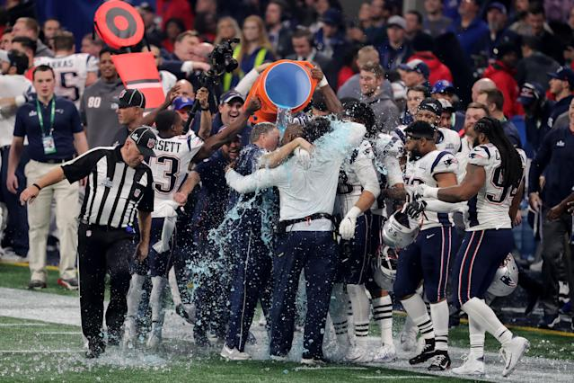 <p>New England Patriots players give head coach Bill Belichick a Gatorade shower after winning the Super Bowl LIII at Mercedes-Benz Stadium on February 3, 2019 in Atlanta, Georgia. The New England Patriots defeat the Los Angeles Rams 13-3. (Photo by Elsa/Getty Images) </p>