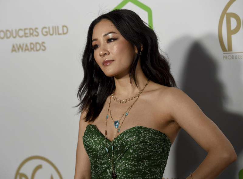 Constance Wu arrives at the 2020 Producers Guild Awards at the Hollywood Palladium on Saturday, Jan. 18, 2020, in Los Angeles, Calif. (AP Photo/Chris Pizzello)