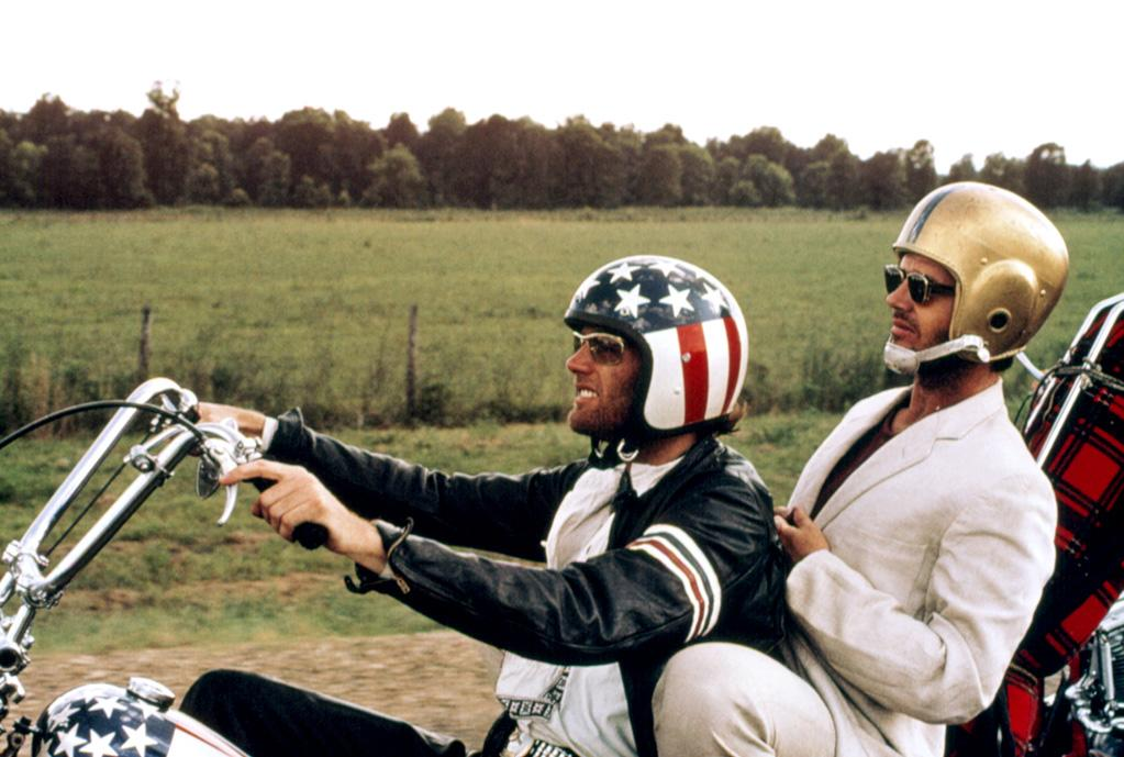 """<a href=""""http://movies.yahoo.com/movie/1800060688/info"""">Easy Rider</a> (1969): The performance that made him a star. In an iconic film in its own right, Nicholson burst out with his portrayal of the seemingly straight-laced but truly alcoholic lawyer George Hanson. The scene in which he smokes pot for the first time around a bonfire with Dennis Hopper and Peter Fonda -- """"You mean marijuana? Lord have mercy, is that what that is?"""" -- then shares his theories about UFOs is, of course, hilarious. But the image of him riding on the back of Fonda's motorcycle in a suit and a football helmet sums up the film's delightful contradictions and sense of adventure."""