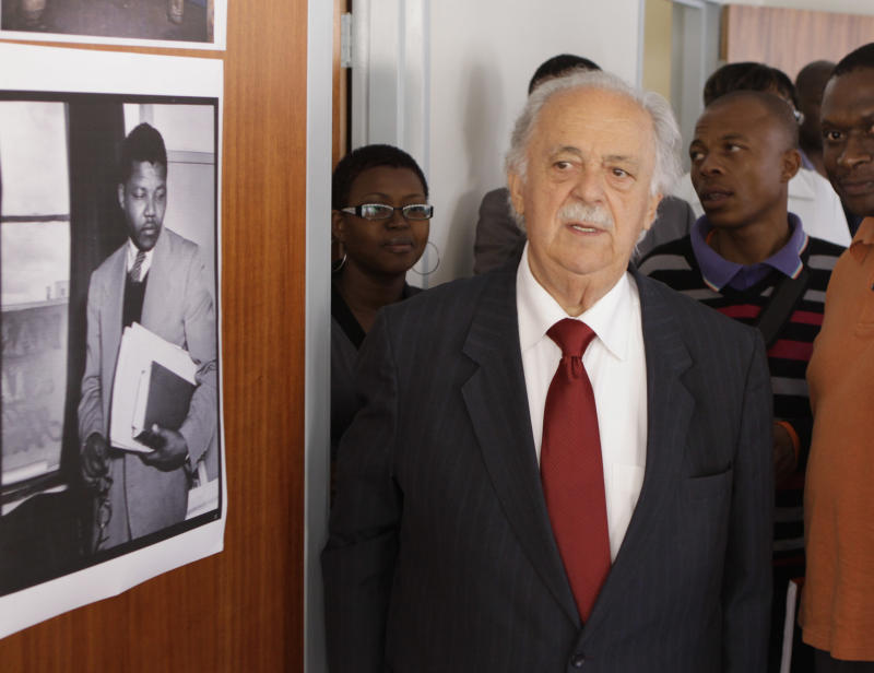 Advocate George Bizos tours the building Wednesday May 4, 2011 where Nelson Mandela and Oliver Tambo had a historic law office in Johannesburg. The building, Chancellor House, was on the verge of collapse and is being turned into a museum and archive. Mandela, photographed as a young lawyer, left, and Tambo who each would go on to lead the African National Congress, opened the first black-owned law firm in the building in 1952 and closed it in 1960, when their political work made it impossible to keep practising. (AP Photo/Denis Farrell)